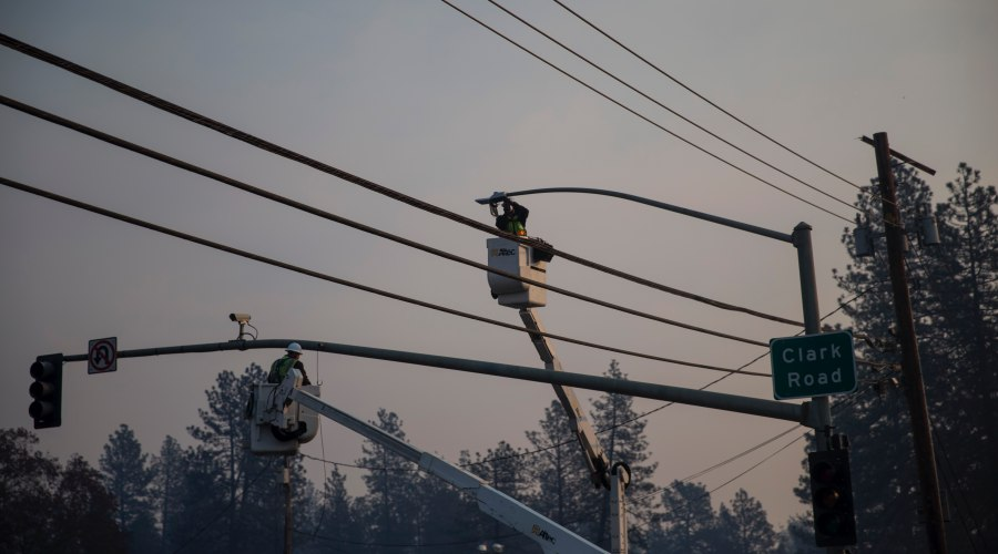 Power crews work on lines in the aftermath of the Camp Fire in Paradise, Calif.